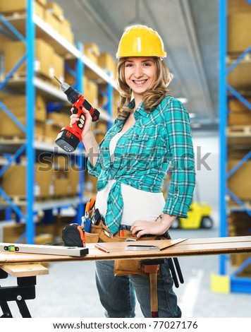 woman constructor in classic warehouse