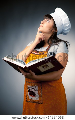 woman cook holding recipes book and thinking what to cook