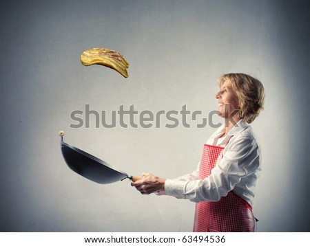 Woman cooking a pancake