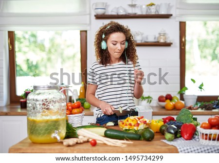 Woman cooking in good mood