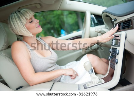 woman cooling herself with air conditioner in her car