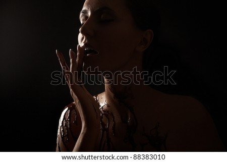 Woman covered in melted chocolate