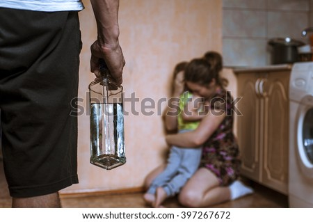 woman covering her child from...
