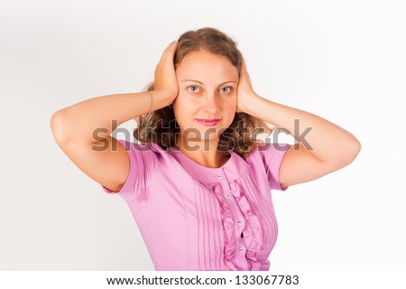 Woman covering her ears - Hear no evil over white background
