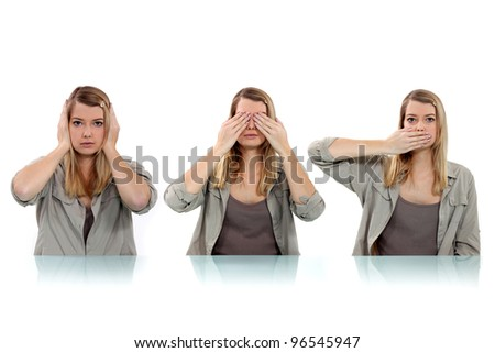 woman covering her eyes, ears and mouth with her hands