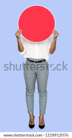Woman covering her face by a blank board #1218912076