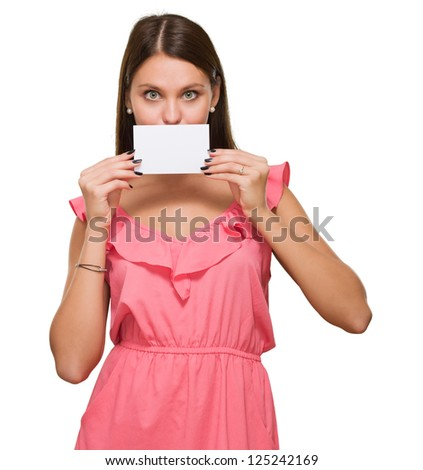 Woman Covering Her Mouth With Blank Placard against a white background