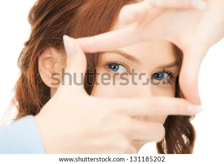 woman creating a frame from fingers or snapshot