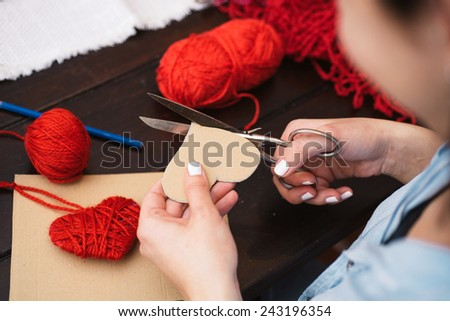 Woman creating red woolen heart #243196354
