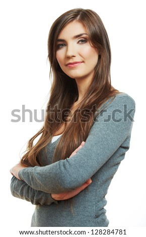 Woman crossed arms standing against white. Confident pose