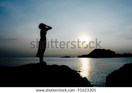 woman cry stand inside the sea sunset alone