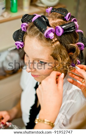 Woman curling hair