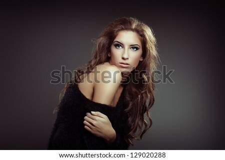 Woman curly hair on a gray background