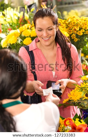 Woman customer taking receipt flower shop buying credit card