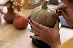 Woman cut cap ceramic pumpkin