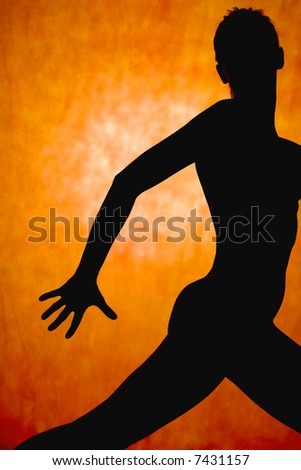 woman dance, silhouette in front of orange background