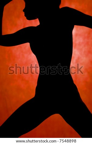 woman dance, silhouette in front of orrange background