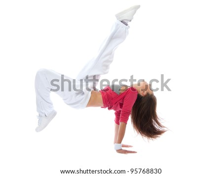 Woman dancer jump acting like hit soccer ball pose isolated on a white background
