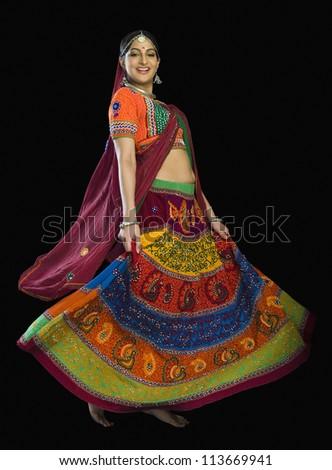 Woman dancing in colorful lehenga choli