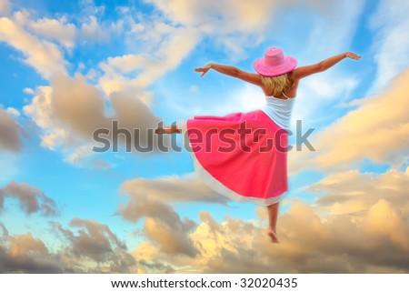 Woman dancing in the sky on cloud #32020435