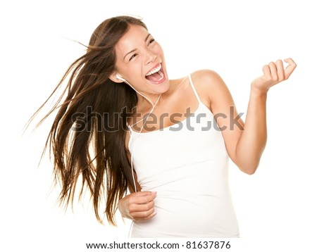 Woman dancing to music listening to mp3 player with earphones / earbuds. Energetic air guitar move by happy Asian / Caucasian dancer isolated on white background.