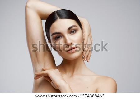woman dark hair clear skin arm raised arm armpit