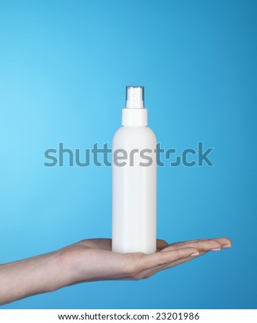 woman demonstrating a white can on blue background