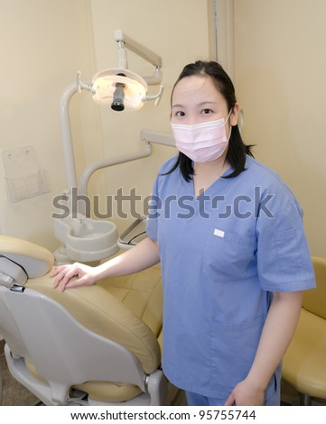 woman dentist at her office