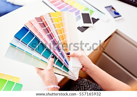 Woman designer or architect choosing color from color palette
