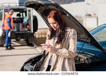 Woman dialing her phone after car breakdown problem mechanic crash