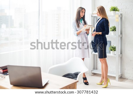 Woman doctor explaining diagnosis prescribe to her female patient concept  healthcare, medical, hospital