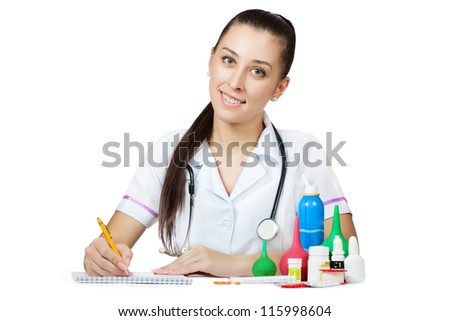 woman doctor in a white coat is writing a prescription. isolated on white