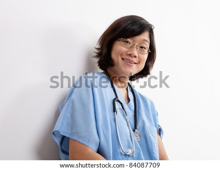 Woman Doctor or Nurse Seated on Floor at Laptop Computer