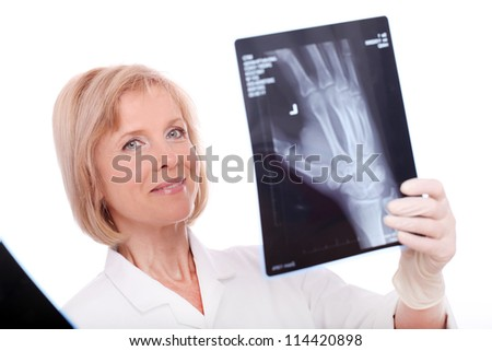 Woman doctor with xray image over white background