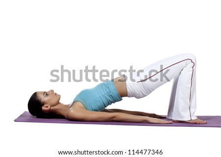 Woman doing a back bending pose to increase flexibility in her spine and also stretches out her shoulders and the back of her neck