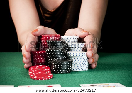 stock photo : Woman doing all-in playing poker. Save to a lightbox ▼