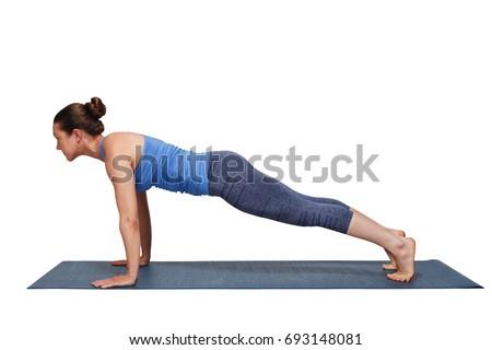 Woman doing Ashtanga Vinyasa yoga Surya Namaskar Sun Salutation asana Utthita chaturanga dandasana - extended four-limbed pose