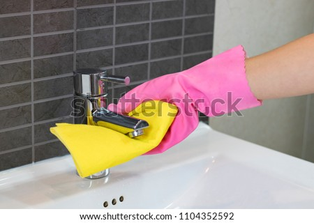 Woman doing chores in bathroom, cleaning of water tap Foto stock ©