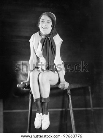 Woman doing gymnastics on parallel bars