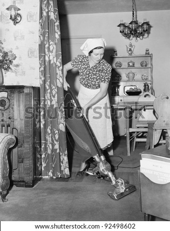 woman doing housework with a...