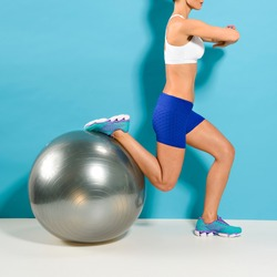Woman doing lunge exercise with a stability ball. A work out that strengthens the legs and glutes while also working on balance and stability.