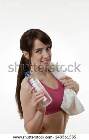 woman doing or just done a work out with a white towel around her neck