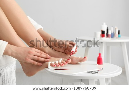 Woman doing pedicure at home