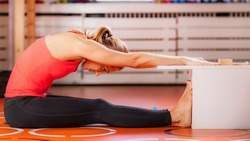 Woman doing sit and reach flexibility test