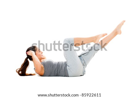 woman doing strength exercises for abdominal muscles. isolated on white background