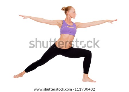 Woman doing warrior yoga pose on white background
