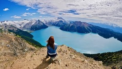Woman doing yoga above alpine lake. Panorama Ridge. Garibaldi Lake. Garibaldi Provincial Park. Whistler. British Columbia. Canada.