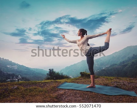 woman doing yoga asana...