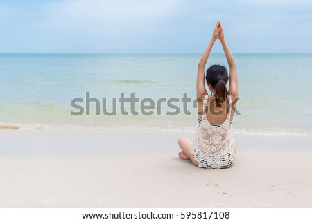 Stock Photo Woman doing yoga at beach