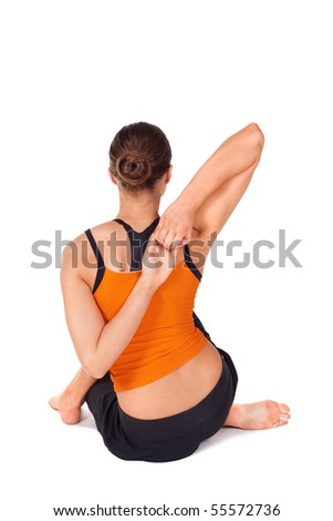Woman doing yoga exercise called Cow Face Pose, sanskrit name: Gomukhasana, pose useful in arthritis and dry piles, removes pain in hip and lower extremities, isolated on white